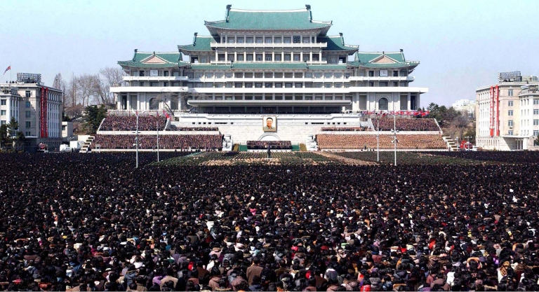 <p>Pyongyang's Kim Il Sung square crammed with people for a national memorial service on the 100th day since the death of late leader Kim Jong Il. The picture was taken by North Korea's official Korean Central News Agency on March 25, 2012.</p>