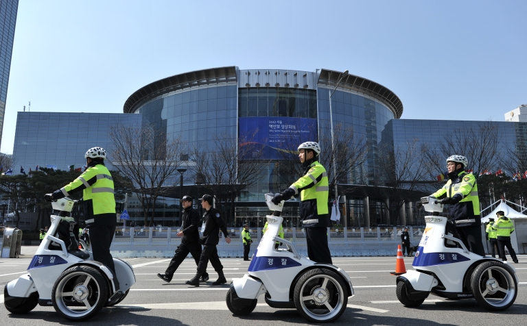 <p>South Korean police patrol outside the venue where the 2012 Seoul Nuclear Security Summit will take place in Seoul on March 26, 2012.</p>