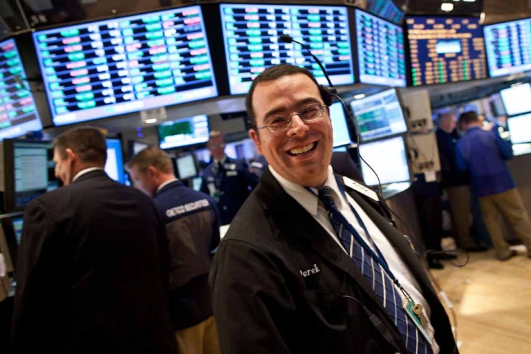<p>A trader works on the floor of the New York Stock Exchange on March 26, 2012 in New York City. The market soared to a 12-month high after comments made by Ben Bernanke regarding the economy.</p>