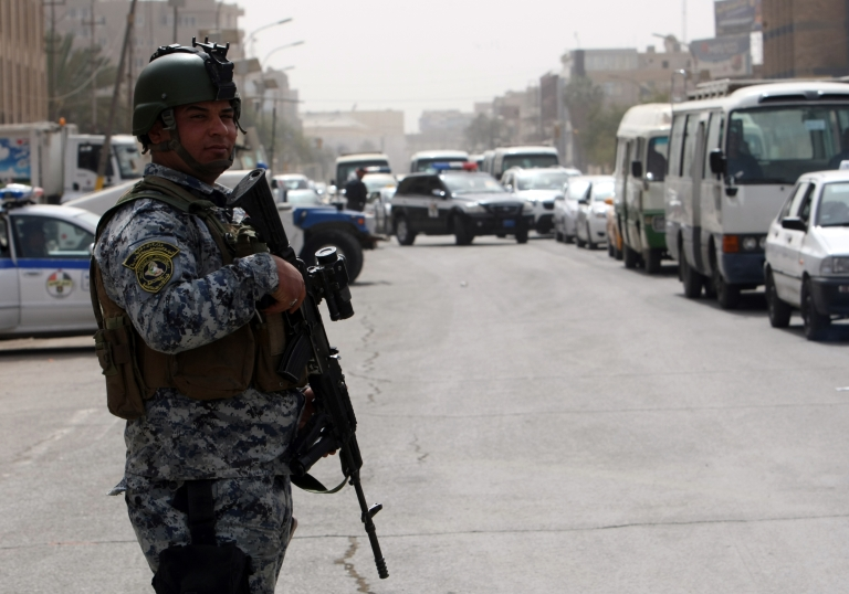 <p>Iraqi security forces set up checkpoints on streets leading to the heavily fortified Green Zone in Baghdad on March 27, 2012.</p>