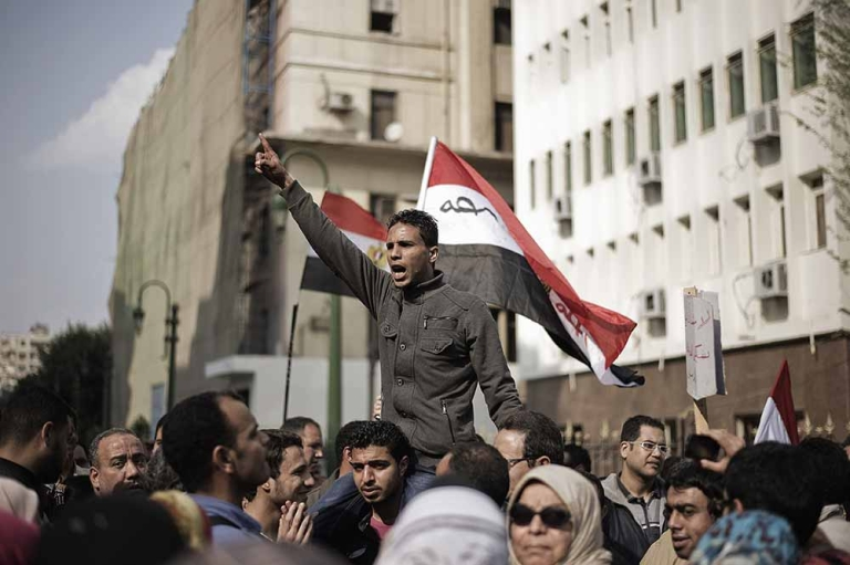 <p>Hundreds of protesters demonstrate outside the Egyptian parliament building against the current Constitution Drafting Committee on March 28, 2012 in Cairo. Liberal and leftist parties have pulled out of a panel drafting Egypt's new constitution, they announced on March 27, accusing Islamists of monopolizing the process that will deliver the country's post-revolution charter.</p>