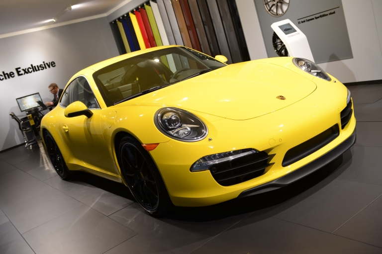 <p>The Porsche 911, declared the 2012 Performance Car of the Year, in on display during the second day of press previews at the New York International Automobile Show on April 5, 2012 in New York.</p>