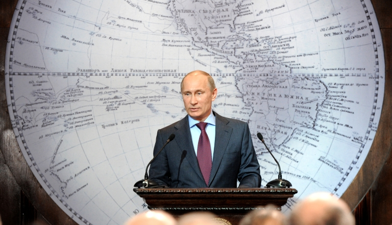 <p>Russia's Prime Minister and President-elect Vladimir Putin (C) speaks in the Russian Geographical Society in St. Petersburg, on April 10, 2012.</p>