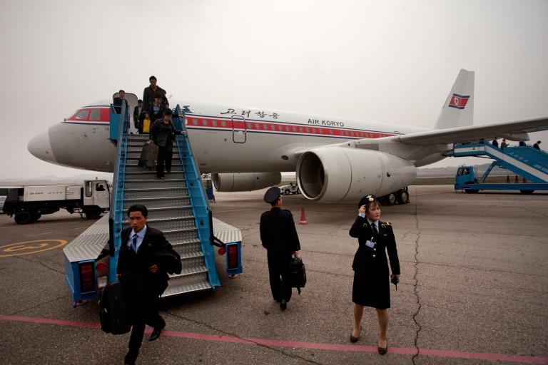 <p>Travellers disembark from an Air Koryo Topolev 504 aircraft upon arrival at Pyongyang airport on April 12, 2012.</p>