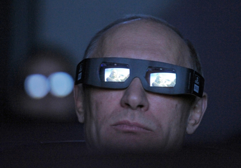 <p>Russia's Prime Minister Vladimir Putin looks on through 3D glasses during his visit to Moscow's Planetarium, on April 12, 2012.</p>