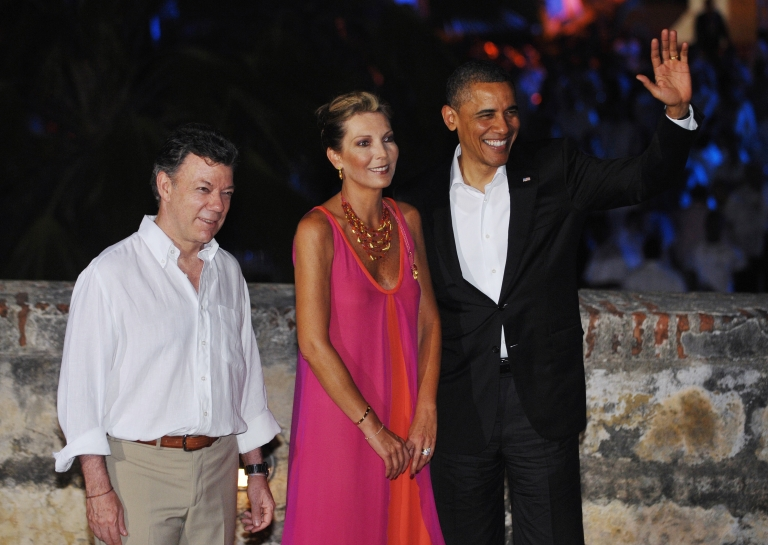 <p>Colombian President Juan Manuel Santos Calderón greets US President Barack Obama upon arrival at Castillo San Felipe de Barajas, the largest colonial fort in Colombia, for a Summit of the Americas leaders' dinner April 13, 2012 in Cartagena, Colombia.</p>