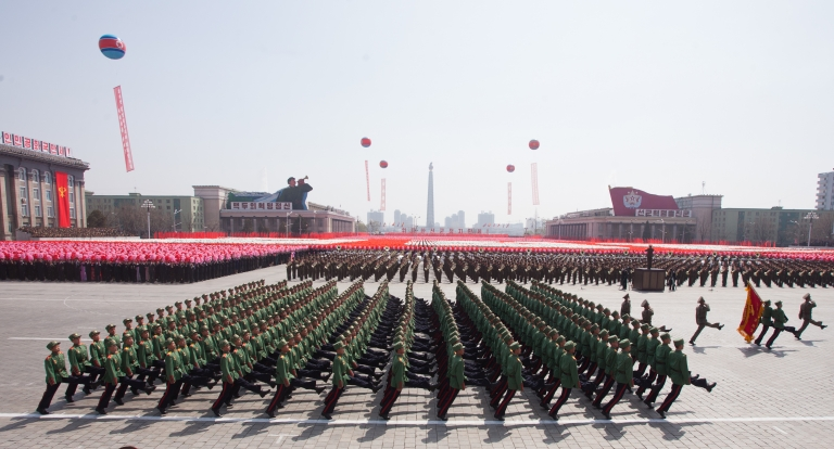 <p>North Korean soldiers march during a military parade in honour of the 100th birthday of the late North Korean leader Kim Il-Sung in Pyongyang on April 15, 2012.</p>