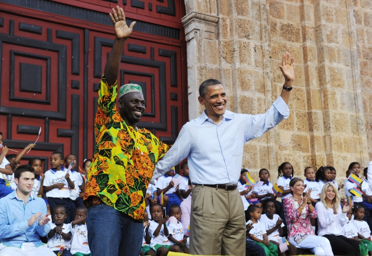 <p>US President Barack Obama (R) waves with a representative of the Afro-Colombia community after he spoke at an event to hand over land titles at the Plaza de San Pedroin Cartagena, Colombia on April 15, 2012 .</p>