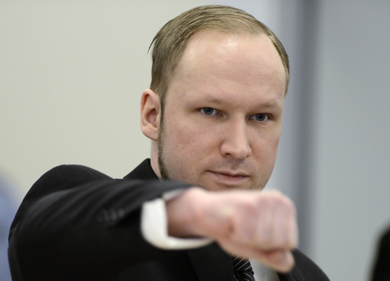 <p>Self-confessed mass murderer and right-wing extremist Anders Behring Breivik clenches his fist in a salute as he arrive on day three in room 250 at the central court in Oslo on April 18, 2012.</p>