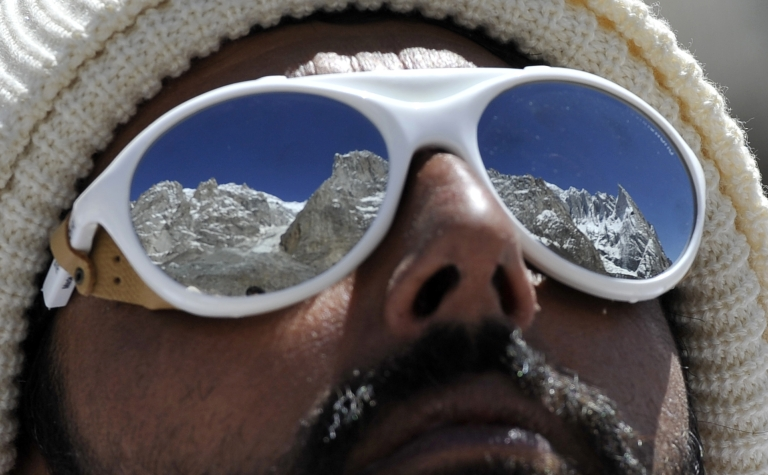 <p>A Pakistani soldier wearing sunglasses looks on at the avalanche site during an ongoing operation at Gayari camp near the Siachen glacier on April 18, 2012. Rescuers are still searching for nearly 140 soldiers buried by the mass of snow and rock at Gayari camp near the Siachen glacier, 4,000 metres above sea level.</p>