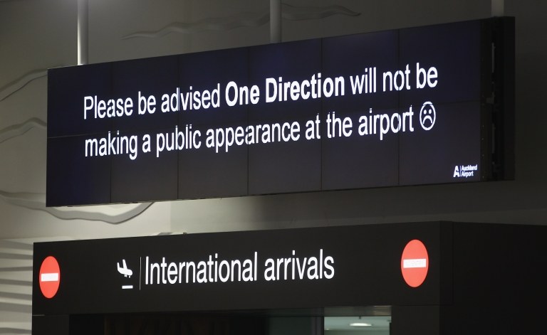 <p>A sign advises One Direction fans at Auckland International Airport on April 19, 2012 in Auckland, New Zealand.</p>