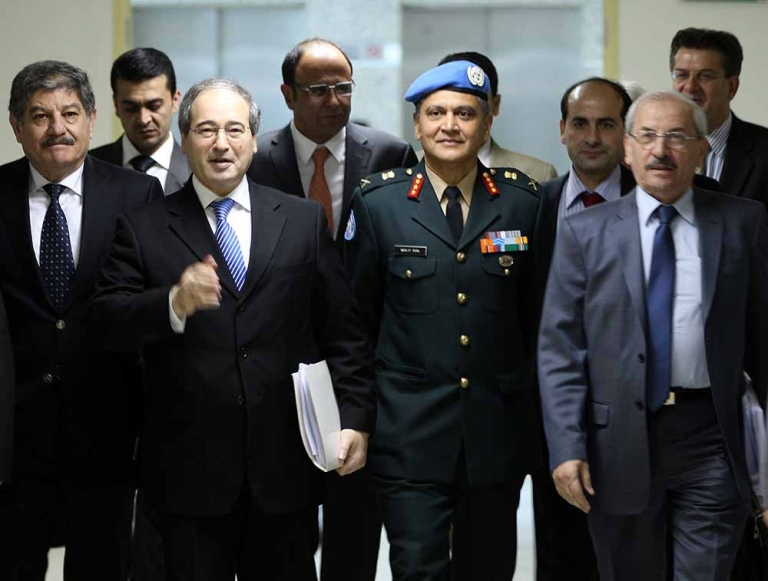 <p>Syrian Deputy Foreign Minister Faisal Meqdad (second left) walks along side deputy military adviser in the UN Department of Peacekeeping Operations Gen. Abhijit Guha, as they arrive to sign a preliminary accord on April 19, 2012, in Damascus, outlining a protocol for a UN mission to monitor a fragile week-old ceasefire in the strife-torn country.</p>