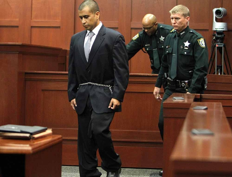 <p>George Zimmerman enters into the courtroom of Circuit Judge Kenneth Lester on April 20. 2012, in Sanford, Florida, for a bond hearing in the shooting death of Trayvon Martin. Judge Lester set a 150,000 USD bond for the pre-trial release of the neighborhood watch volunteer charged with murdering unarmed black teenager Trayvon Martin. The judge also imposed certain conditions on Zimmerman's release, including that he submit to electronic GPS tracking, a curfew and to periodically report to authorities.</p>