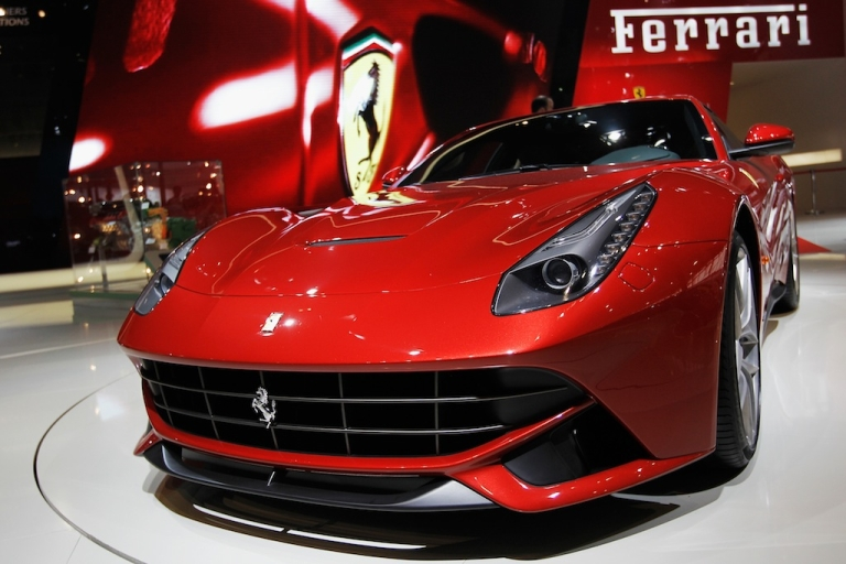 <p>A Ferrari F12 berlinetta car is displayed during the media day of the 2012 Beijing International Automotive Exhibition at Beijng International Exhibition Center.</p>