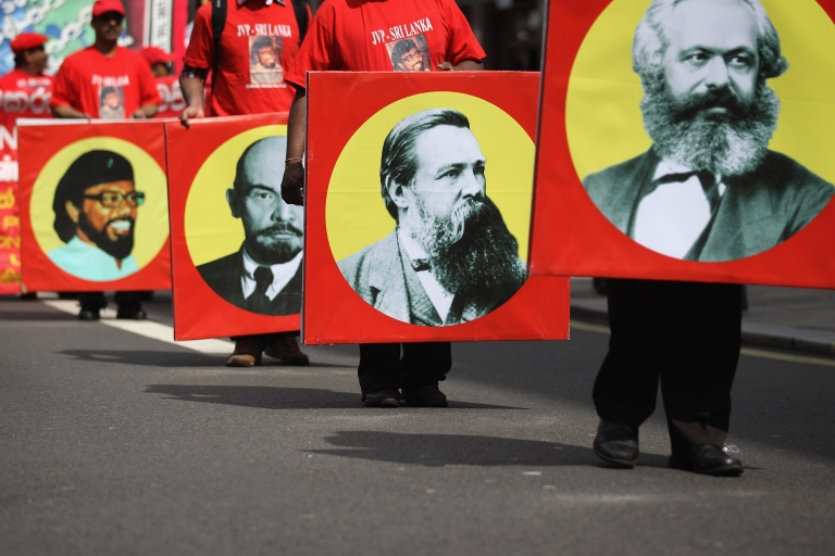 <p>Communist protesters march during a demonstration on May 1, 2012 in London, England.</p>
