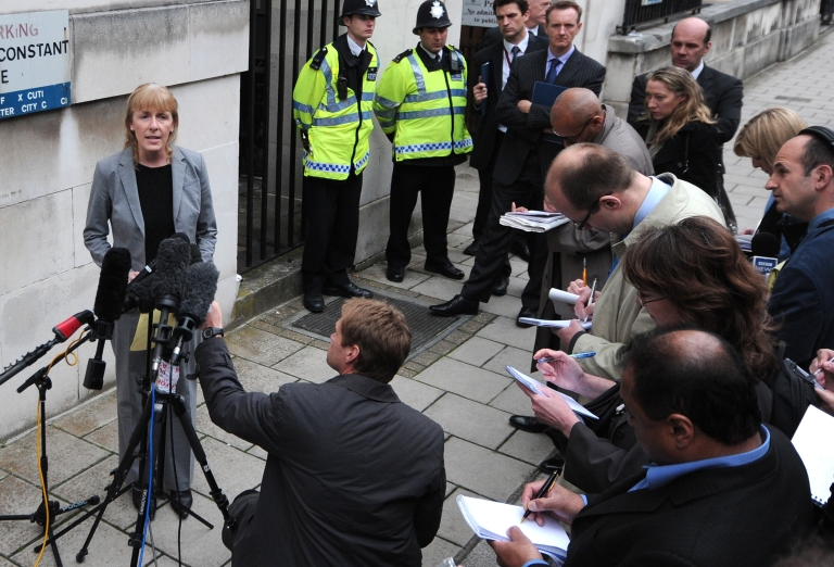 <p>Detective Chief Inspector Jackie Sebire (L), senior investigating officier in the case of the death of British MI6 officer Gareth Williams who was found dead in inside a sports bag in his flat in 2010, gives a statement outside Westminster Coroners Court in central London on May 2, 2012, after a narrative verdict was announced into the mysterious death.</p>