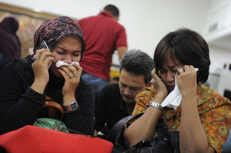 <p>Indonesian relatives of passengers of the Russian Sukhoi Superjet 100 cry at Halim Perdanakusuma airport in Jakarta on May 10, 2012 as rescuers search for survivors at crash site in Mount Salak in Western Java province.</p>