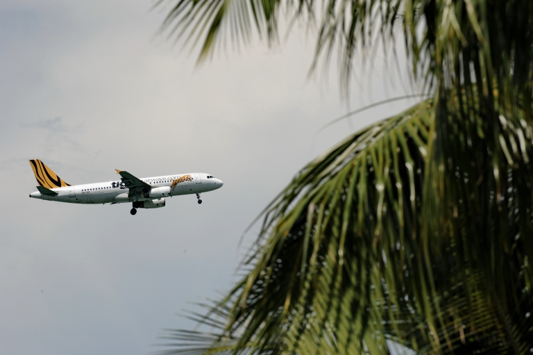 <p>A plane from the low-cost airline Singapore airline Tiger Airways plane approaches Changi International airport for landing.</p>