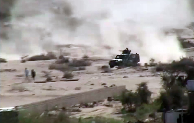 <p>An image taken with a mobile phone allegedly shows an armed vehicle driving in Loder, in the restive southern Abyan province, as clashes continued between Al Qaeda militants and the Yemeni army forces on May 16, 2012.</p>