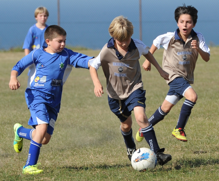 <p>Australian schoolboys compete in an inter-school football match on May 19, 2012.</p>