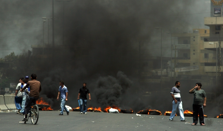 <p>A road is blocked by burning tires after Lebanese Sunni cleric Ahmad Abdel Wahed was shot dead by Lebanese army troops when his convoy failed to stop at a checkpoint in the northern Lebanese town of Halba on May 20, 2012.</p>