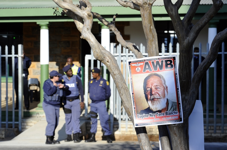 <p>A portrait of white supremacist Eugene Terre'Blanche hangs outside the Ventersdorp Magistrate court before the verdict in his murder trial on May 22, 2012</p>