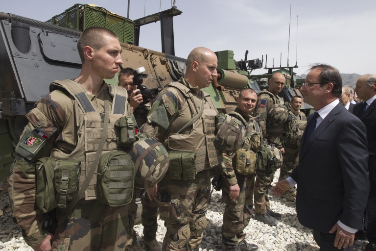 <p>French President Francois Hollande reviews troops, on May 25, 2012 during a visit to a military base in Kapisa, in Afghanistan.</p>