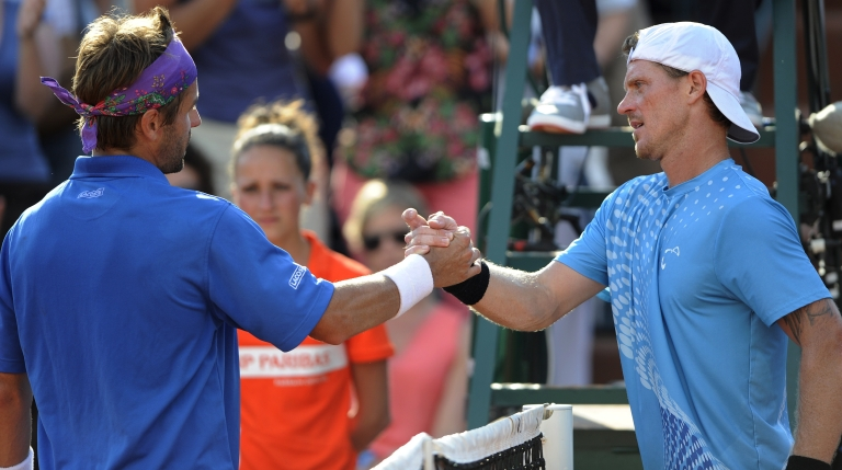 <p>France's Arnaud Clement (L) shakes hands with Russia's Alex Bogomolov Jr at the end of their men's Singles 1st Round tennis match of the French Open tennis tournament May 28, 2012.</p>