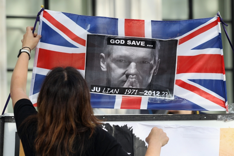 <p>Supporters of Wikileaks founder Julian Assange demonstrate outside the UK Supreme Court prior to Mr Assange's extradition appeal on May 30, 2012 in London, England.</p>