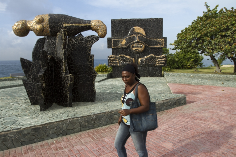 <p>A woman passes by the monument that commemorates the place where Dominican dictator (1930-61) Rafael Leonidas Trujillo was executed on May 30, 1961, in Santo Domingo, on May 30, 2012.</p>