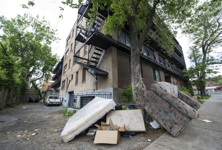 <p>A mattress and sofa reportedly taken out of the apartment of Luka Magnotta lie just outside an apartment building in Montreal on May 31, 2012.</p>