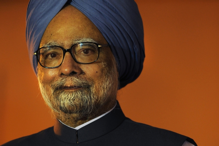 <p>Indian Prime Minister Manmohan Singh gestures as he attends a function at The Bose Institute in Kolkata on June 2, 2012.</p>