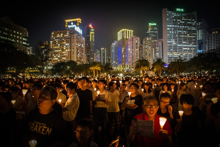 <p>People take part in a a candlelight vigil in Hong Kong on June 4, 2012 held to mark the crackdown on the pro-democracy movement in Beijing's Tiananmen Square in 1989. Hundreds, perhaps thousands, are believed to have died when the government sent in tanks and soldiers to clear Tiananmen Square, bringing a violent end to six weeks of pro-democracy protests.</p>