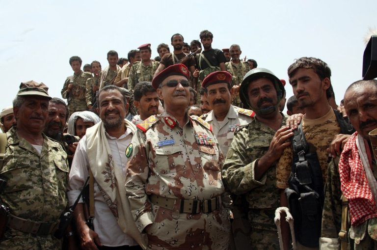 <p>Yemeni Defense Minister Major General Muhammad Nasir Ahmad, center, in the southern Abyan province, on June 10, 2012.</p>