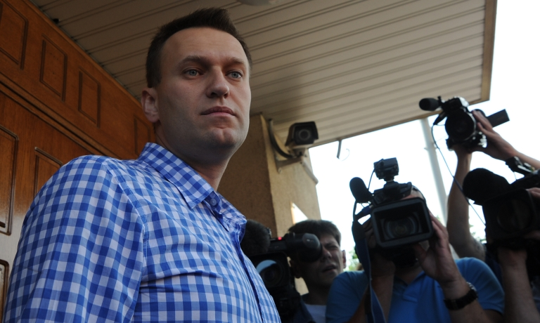 <p>Russian anti-corruption blogger Alexei Navalny stands a the entrance to a Federal Investigative Commision office in Moscow as he arrives for questioning, a part of a probe into last month's demonstration with bloody battles between riot police and the mostly young crowd.</p>