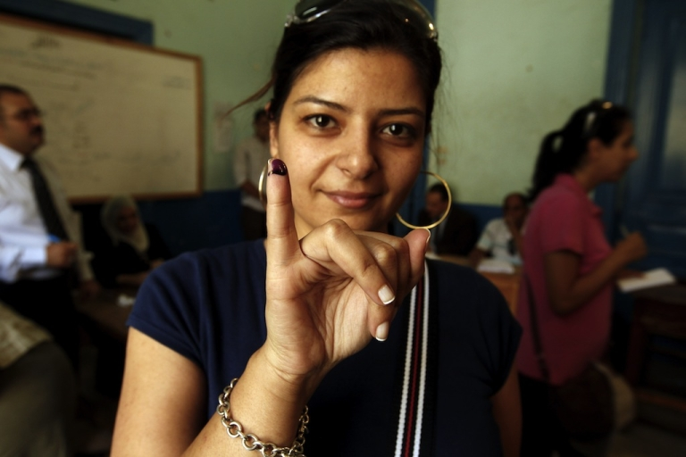 <p>An Egyptian woman shows her ink-stained finger after casting her vote at a polling station in Cairo on June 16, 2012. When it comes to women's rights, religion isn't the decisive factor many once thought it was. Instead, new polling shows the economy is more to blame.</p>