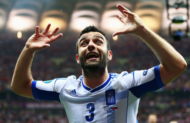 <p>Giorgos Tzavelas of Greece celebrates victory and progress to the quarter finals during the UEFA Euro 2012 group A match between Greece and Russia at The National Stadium on June 16, 2012 in Warsaw, Poland.</p>