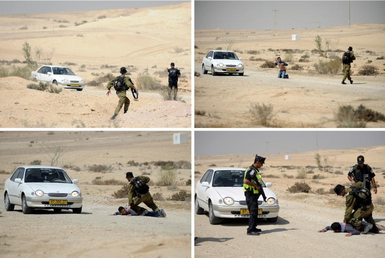 <p>A combination of pictures shows Israeli policemen and a soldier detaining an Arab-Israeli after he tried to pass a road block made by the police in the Israeli Negev desert, south of Beer Sheva on June 18, 2012.</p>