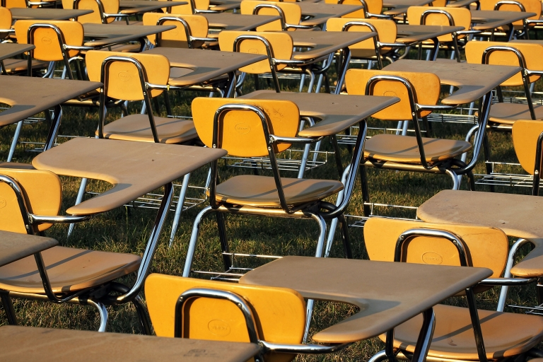 <p>College Board set up an installation of 857 desks to represent the number of students in the United States who drop out of school each hour of a school day.</p>