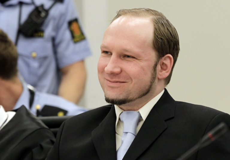 <p>Right-wing extremist Anders Behring Breivik gestures on the last day of his trial on June 22, 2012.</p>