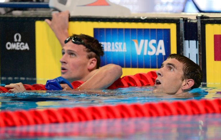 <p>Ryan Lochte (R) and Michael Phelps look on after they competed in the championship final heat of the Men's 400 m Individual Medley during the 2012 U.S. Olympic Swimming Team Trials at CenturyLink Center on June 25, 2012 in Omaha, Nebraska</p>
