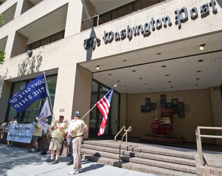 <p>Postal activists demonstrate in front of the Washington Post offices June 27, 2012 in Washington, DC.</p>