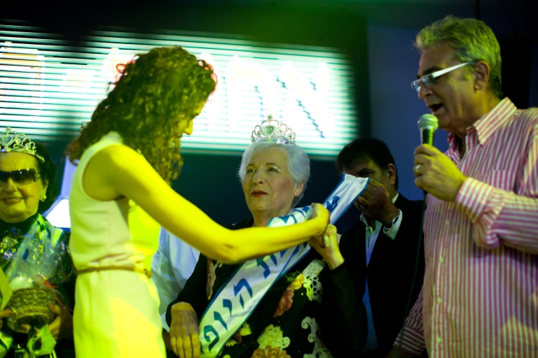 <p>Israeli Holocaust survivor and winner of the Holocaust survivors beauty pageant, Chava Hershkovitz, 78, is awarded during the beauty pageant, on June 28, 2012 in Haifa, Israel. During the pageant, the twenty women competing, between 74 to 90 years of age, shared Holocaust stories witht he audience.</p>