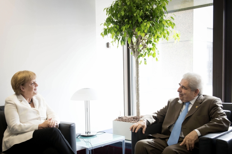 <p>German Chancellor Angela Merkel (L) and Cyprus's president Demetris Christofias speak during the euro zone meeting in Brussels, Belgium, on June 29, 2012.</p>