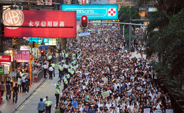 <p>Thousands of protesters take to the streets calling for universal suffrage and chanting slogans against new Hong Kong Chief Executive Leung Chun-ying in Hong Kong on July 1, 2012 only hours after Chinese President Hu Jintao completed his three-day visit to the southern Chinese territory. Hong Kong's new leader Leung Chun-ying, who earlier in the day was sworn in at an inauguration ceremony, took over the city of seven million people amid falling popularity ratings, a series of setbacks and protests over his leadership before he even started his term.</p>