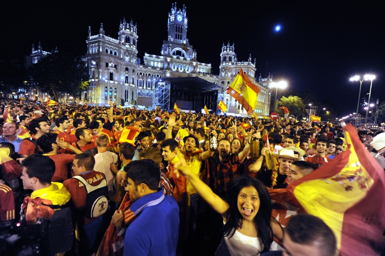 <p>Supporters of Spain's national football team celebrate in central Madrid after their team defeated Italy 4-0 in the Euro 2012 soccer Championships.</p>