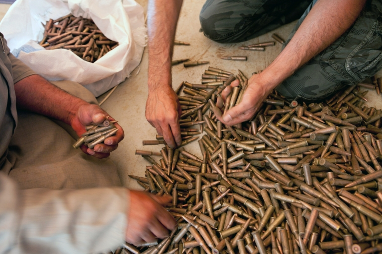 <p>Fighters from the Free Syrian Army buy AK-47 bullets from a weapons seller in Idlib Province on July 4, 2012.</p>