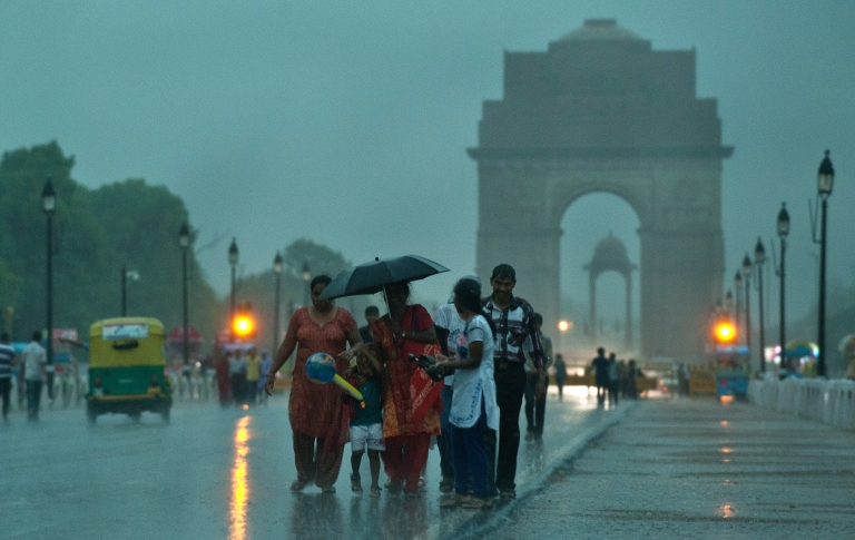 <p>People enjoy the pre-monsoon showers bringing relief from the heat in New Delhi on July 6, 2012. The monsoon is described as the 'economic lifeline' of India, which has a population of 1.2 billion and is one of the world's leading producers of rice, sugar, wheat and cotton.</p>