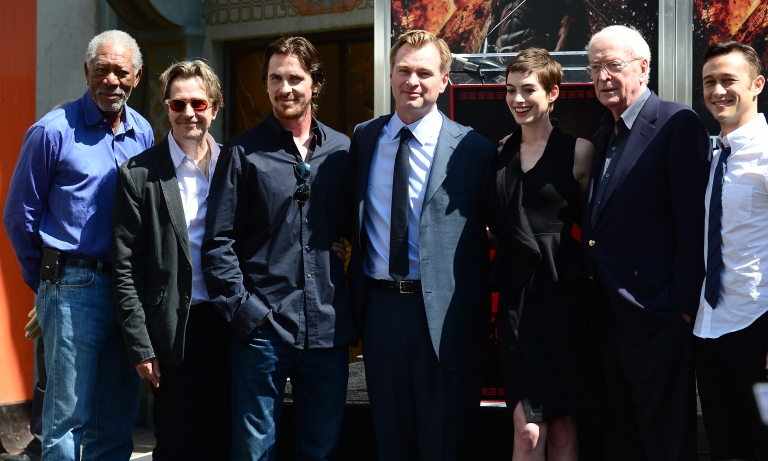 <p>Director Christopher Nolan (C) poses with cast members attending his Hand and Foot print ceremony in front of Grauman's Chinese Theater in Hollywood on July 7, 2012 in California.</p>