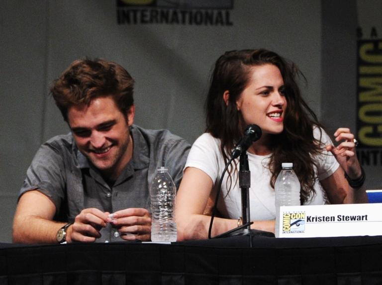 <p>Actors Robert Pattinson (L) and Kristen Stewart speak at 'The Twilight Saga: Breaking Dawn Part 2' Panel during Comic-Con International 2012 at San Diego Convention Center on July 12, 2012 in San Diego, California.</p>